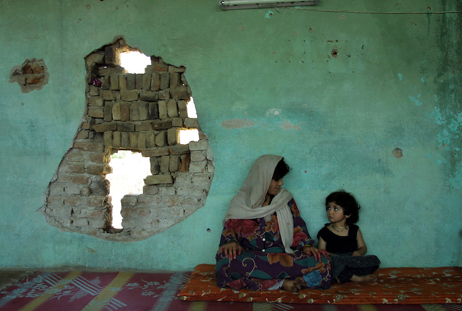 A family squatting in an abandoned building in Kabul.
