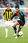 Nederland, Nijmegen, 3 februari 2013.Eredivisie .Seizoen 2012-2013.N.E.C.-Vitesse.Navarone Foor (r.) van N.E.C. in actie met bal. Links Tomas Kalas van Vitesse.