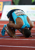 22 AUG 2013 - STOCKHOLM, SWE - Ayanleh Souleiman of Djibouti celebrates winning the men's 1500m race in a time of 3:33:59 during the DN Galen meet of the 2013 Diamond League at the Stockholm Olympic Stadium in Stockholm, Sweden (PHOTO COPYRIGHT © 2013 NIGEL FARROW, ALL RIGHTS RESERVED)