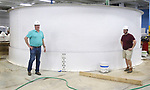 WATERBURY CT. 23 June 2017-062317SV01-From left, Eric Pedersen, president and Matt Dawson, facility manager, stand by a 25,000 gallon tank that will be use to house European sea bass  at Great American Aquaculture in Waterbury Friday. <br /> Steven Valenti Republican-American