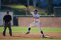 High Point Panthers first baseman Jordan Sergent (9) stretches for a throw as umpire Gerald Trexler looks on during the game against the NJIT Highlanders at Williard Stadium on February 19, 2017 in High Point, North Carolina. The Panthers defeated the Highlanders 6-5. (Brian Westerholt/Four Seam Images)