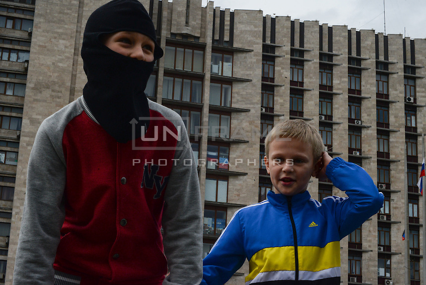 Pro-russian activist's children playing with masks in Slovyansk