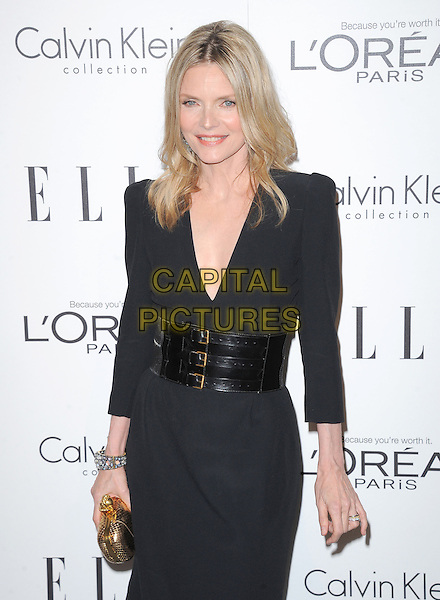 Michelle Pfeiffer.18th Annual ELLE Women in Hollywood celebration held at The Four Seasons in Beverly Hills, California, USA..October 17th, 2011.half length black dress clutch bag belt gold.CAP/RKE/DVS.©DVS/RockinExposures/Capital Pictures.