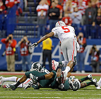 Ohio State Buckeyes quarterback Braxton Miller (5) gets stopped by Michigan State Spartans linebacker Denicos Allen (28) on a 4th and 1 in the 4th quarter during the Big 10 Championship game at Lucas Oil Stadium in Indianapolis, Ind on December 7, 2013.  (Dispatch photo by Kyle Robertson)