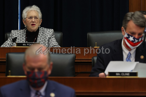 United States House Education and Labor Committee ranking member US Representative Virginia Foxx (Republican of North Carolina) does not wear a face mask while her fellow committee members do during a hearing about the federal government's role in protecting workers during the pandemic on Capitol Hill May 28, 2020 in Washington, DC. More than 62,000 health care workers have been infected with COVID-19 and close to 300 have died according to the U.S. Centers for Disease Control. <br /> Credit: Chip Somodevilla / Pool via CNP/AdMedia