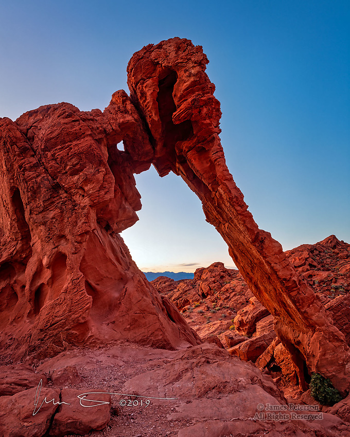 Elephant Rock at Dawn, Nevada.  This sandstone arch is just one among a countless number of them in Valley of Fire State Park, but it certainly stands out.<br /> <br /> Image © 2019 James D Peterson.