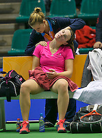 20-12-13,Netherlands, Rotterdam,  Topsportcentrum, Tennis Masters, , , Angelique van der Meet(NED)  receives a medical treatment by fysio<br /> Photo: Henk Koster