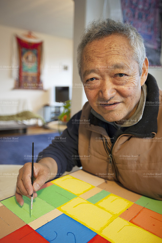 Switzerland. Canton Bern. Muri. Thubten Purang is a an artist. He is working at home on his latest colorful painting. The swiss tibetan man is an Aeschimann's child who arrived 50 years ago in Switzerland to receive custody on a private initiative by an influential Swiss industrialist, Charles Aeschimann. In 1962, Charles Aeschimann agreed with the Dalai Lama to take 200 children and place them in Swiss foster homes and give them a chance for a better life and a good education. Most of the children still had parents in exile or in Tibet, just a few were orphans. 24.02.2015 © 2015 Didier Ruef