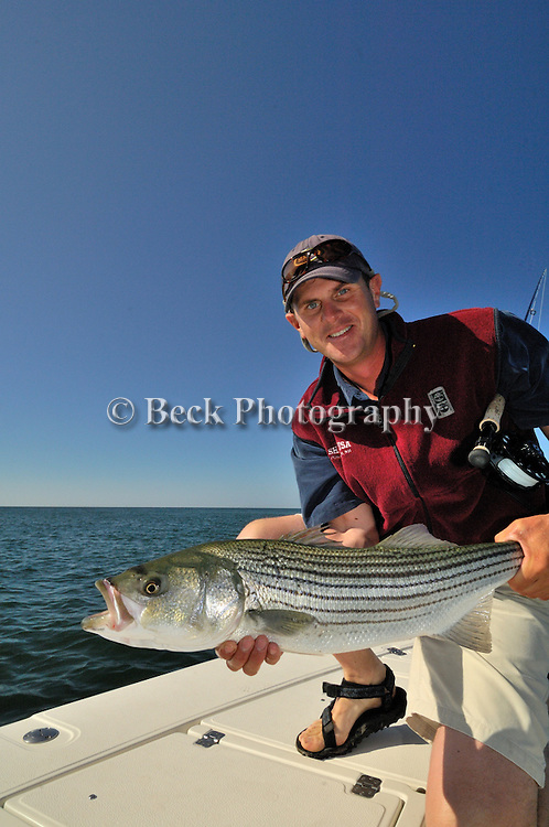TODD MURPHY WITH A STRIPED BASS