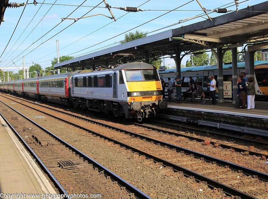 Greater Anglia, British Rail Class 90 electric locomotive train platform station, Ipswich, Suffolk, England, UK