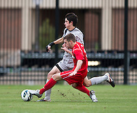 Andy Riemer (20) of Georgetown has the ball tackled away from him by Jack Bennett (11) of St. John's during the game at North Kehoe Field in Washington DC. Georgetown defeated St. John's, 2-1, in the Big East conference tournament quarterfinals.