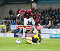 5th January 2020; Pirelli Stadium, Burton Upon Trent, Staffordshire, England; English FA Cup Football, Burton Albion versus Northampton Town; Stephen Quinn of Burton Albion with a sliding tackle for the ball from Vadaine Oliver of Northampton Town  - Strictly Editorial Use Only. No use with unauthorized audio, video, data, fixture lists, club/league logos or 'live' services. Online in-match use limited to 120 images, no video emulation. No use in betting, games or single club/league/player publications