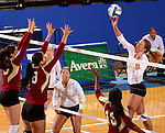 BROOKINGS, SD - OCTOBER 3:  Moni Corrujedo #10 and Erica Denney #8 from Denver look to block a kill attempt by Emily Veldman #12 from South Dakota State University in the first game of their match Friday night at Frost Arena. (Photo/Dave Eggen/Inertia)