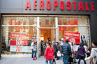Shoppers enter the Aeropostale store in the Herald Square shopping district in New York looking for bargains on Thanksgiving Day, Thursday, November 24, 2011. Many retailers are opening their doors on Thanksgiving or opening up for Black Friday the night before. (© Richard B. Levine)
