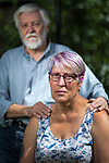 © Joel Goodman - 07973 332324 . 13/08/2017 . Salford , UK . Husband and wife Tony and Joy Watson (70 and 59 respectively) pictured in their garden in Eccles . Joy has Alzheimer's disease and has had to quit her job as a carer . As a campaigner and educator on the needs of people with dementia , she was praised by former Prime Minister David Cameron , who awarded her a Points of Light Award . But she and her retired husband and full-time carer, Tony, say they now struggle to pay their bills after an assessment by the DWP saw all their financial support withdrawn . For more information see http://www.mirror.co.uk/news/uk-news/woman-dementia-praised-david-cameron-10983661 . Photo credit : Joel Goodman