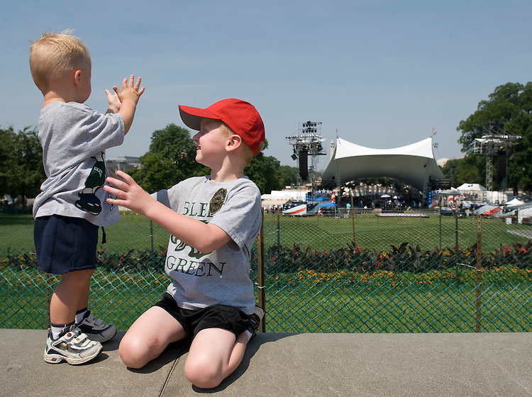 From left, Brody Weachter, age 2, and his 5 year old brother Mason, dance and clap on the West Front of the Capitol as Huey Lewis and the News rehearse on Thursday, July 3, 2008, for the Capitol Fourth 2008 Holiday Concert on the West Lawn.