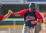 29 June 2014:  Lowell Spinners outfielder Franklin Guzman rounds the bases after hitting a home run against the Vermont Lake Monsters at Centennial Field in Burlington, Vermont. The Spinners defeated the Lake Monsters 7-5 in NY Penn League action. Mandatory Credit: Ed Wolfstein Photo *** RAW Image File Available ****
