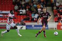 Peter Etebo of Stoke City vies for possession with George Byers of Swansea City during the Sky Bet Championship match between Stoke City and Swansea City at the Bet 365 Stadium in Stoke on Trent, England, UK. Tuesday 18 September 2018