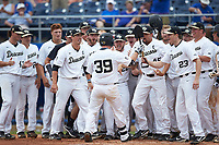 Ben Breazeale (39) of the Wake Forest Demon Deacons is greeted at home plate by his teammates after hitting a walk-off 2-run home run in the bottom of the 11th inning against the Florida Gators in the completion of Game Two of the Gainesville Super Regional of the 2017 College World Series at Alfred McKethan Stadium at Perry Field on June 12, 2017 in Gainesville, Florida. The Demon Deacons walked off the Gators 8-6 in 11 innings. (Brian Westerholt/Four Seam Images)