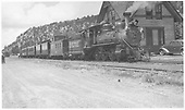 RGS #20 northbound at Dolores depot with caboose, box car and two passenger cars.  This is Nolan Black's California railfan excursion.<br /> RGS  Dolores, CO  Taken by Howe, Dan - 7/16/1947
