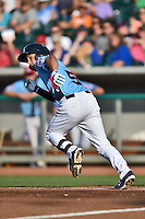 Tennessee Smokies shortstop Elliot Soto #5 runs to first during a game against the Birmingham Barons at Smokies Park on May 31, 2014 in Kodak, Tennessee. The Barons defeated the Smokies 2-1. (Tony Farlow/Four Seam Images)