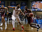 SIOUX FALLS, SD: MARCH 22:  Drew Evans #0 of West Texas A&M drives toward Ferris State defender Markese Mayfield #3 during their game at the 2018 Division II Men's Basketball Championship at the Sanford Pentagon in Sioux Falls, S.D. (Photo by Dick Carlson/Inertia)