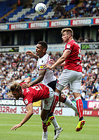 Bolton Wanderers' Josh Magennis competing with Bristol City's Josh Brownhill and Adam Webster<br /> <br /> Photographer Andrew Kearns/CameraSport<br /> <br /> The EFL Sky Bet Championship - Bolton Wanderers v Bristol City - Saturday August 11th 2018 - University of Bolton Stadium - Bolton<br /> <br /> World Copyright &copy; 2018 CameraSport. All rights reserved. 43 Linden Ave. Countesthorpe. Leicester. England. LE8 5PG - Tel: +44 (0) 116 277 4147 - admin@camerasport.com - www.camerasport.com