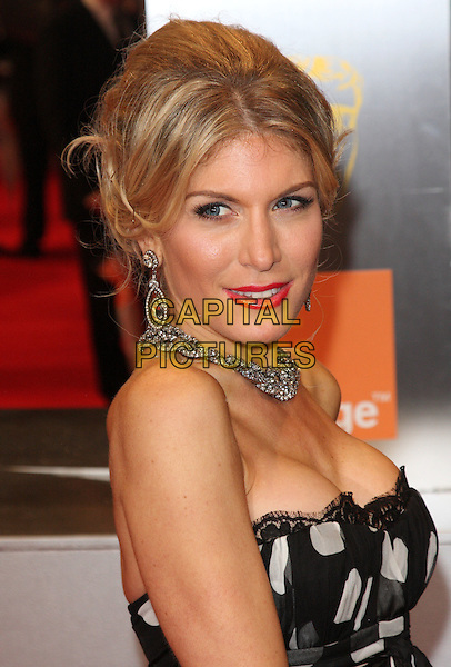 HOFIT GOLAN.2011 Orange British Academy Film Awards (Baftas) at The Royal Opera House, London, England, UK,.February 13th, 2011..arrivals BAFTA portrait headshot strapless black and white polka dot cleavage necklace earring hair up .CAP/ROS.©Steve Ross/Capital Pictures