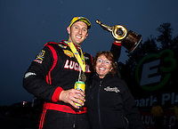 Aug 17, 2014; Brainerd, MN, USA; NHRA top fuel driver Morgan Lucas (left) celebrates with mother Charlotte Lucas after winning the Lucas Oil Nationals at Brainerd International Raceway. Mandatory Credit: Mark J. Rebilas-USA TODAY Sports