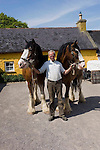 Neilie Cahill holds two Clydesdale working horses at at Muckross Farm Park in Killarney National Park..Picture by Don MacMonagle