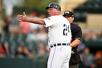 Lakeland Flying Tigers manager Dave Huppert (24) argues a call with umpire Jordan Albarado during a game against the Brevard County Manatees on April 10, 2014 at Joker Marchant Stadium in Lakeland, Florida.  Lakeland defeated Brevard County 6-5.  (Mike Janes/Four Seam Images)