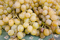 Fresh green grapes on sale at weekly street market in Panzano-in-Chianti, Tuscany, Italy