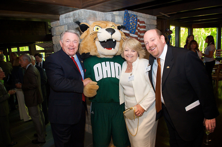 Steven and Barbara Schoonover pose with Rufus and Howard Lipman