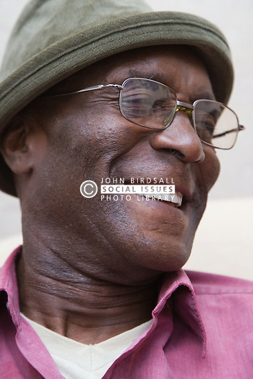 Elderly man smiling,