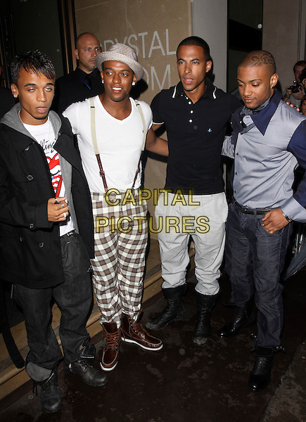 JLS (aka Jack the Lad Swing).The MOBO Awards 2009 Nominations Launch at The Mayfair Hotel, London, England. .August 26th, 2009 .mobos full length Aston Merrygold Ortise Williams Marvin Humes Jonathan Gill white black grey gray hat suspenders braces check trousers top jacket brown blinking funny face .CAP/AH.©Adam Houghton/Capital Pictures.