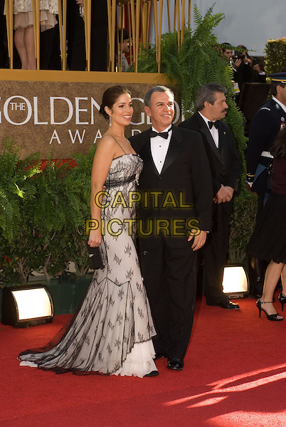 """ANA ORTIZ & TONY PLANA.Red Carpet Arrivals - 64th Annual Golden Globe Awards, Beverly Hills HIlton, Beverly Hills, California, USA..January 15th 2007.globes full length black suit tuxedo dress white lace sheer.CAP/AW.Please use accompanying story.Supplied by Capital Pictures.© HFPA"""" and """"64th Golden Globe Awards"""""""