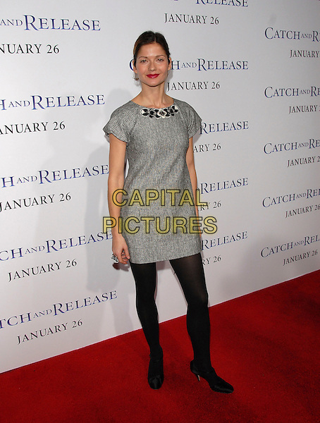 "JILL HENNESSY.attends The Columbia Pictures' World Premiere of .""Catch and Release"" held at The Egyptian Theatre, Hollywood, California, USA, January 22nd 2007..full length grey dress tunic black tights.CAP/DVS.©Debbie VanStory/Capital Pictures"
