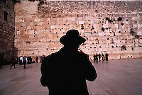 People praying at the Western Wall. Jerusalem, Israel.