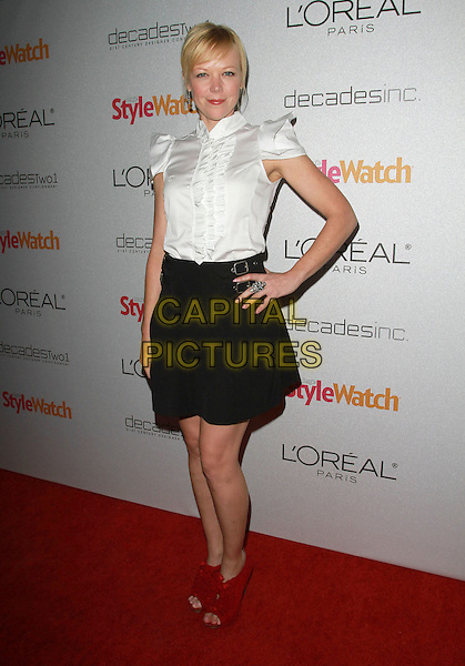 EMILY BERGL.People StyleWatch Hosts 'A Night Of Red Carpet Style' held At Decades, Los Angeles, CA, USA..January 27th, 2011.full length hand on hip black skirt red open toe ankle boots shoes white ruffle blouse shirt.CAP/ADM/KB.©Kevan Brooks/AdMedia/Capital Pictures.