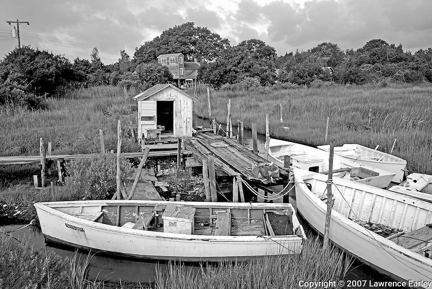 """They used [these skiffs] for mullet fishing, and they'd go to the banks for scalloping, oystering, things like that. Years ago they used to take 'em to kick clams. . . . People used to build them themselves.""--Buster Salter, Atlantic fisherman"
