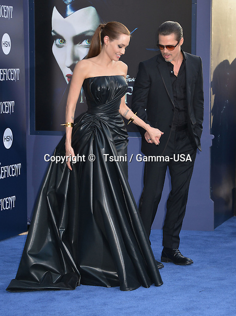 Angelina Jolie and Brad Pitt at the Maleficent Premiere at the El Capitan Theatre in Los Angeles.