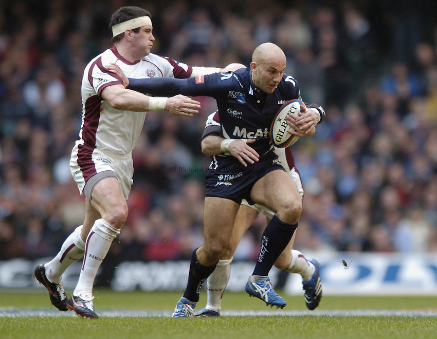 Photo: Jonathan Butler..Sale Sharks v Leicester Tigers. EDF Energy Cup. 24/03/2007..Daniel Larrechea (R) of Sale is tackled by Paul Burke and Shane Jennings of Leicester.