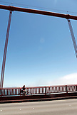 USA, California, San Francisco, a woman bikes across the Golden Gate Bridge on the East side of the bridge