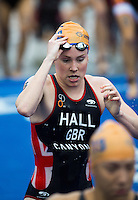 12 JUL 2014 - HAMBURG, GER - Lucy Hall (GBR) from Great Britain heads for transition at the end of the swim at the elite women's 2014 ITU World Triathlon Series round in the Altstadt Quarter, Hamburg, Germany  (PHOTO COPYRIGHT © 2014 NIGEL FARROW, ALL RIGHTS RESERVED)