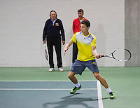 21-02-2014, Netherlands, Eemnes, coach  Michiel Schapers(NED), and Martin Simek looking at their pupil playing without strings in racket<br /> Photo: Henk Koster