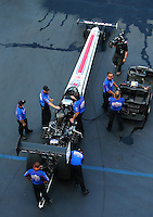 Jun 17, 2016; Bristol, TN, USA; Crew members with NHRA top fuel driver Richie Crampton during qualifying for the Thunder Valley Nationals at Bristol Dragway. Mandatory Credit: Mark J. Rebilas-USA TODAY Sports