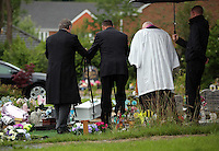 Pictured: Undertaker carry the coffin of baby Sion at the burial site at Thornhill Cemetery, Cardiff, Wales, UK. Tuesday 28 June 2016<br /> Re: The funeral of Sion, the baby boy found dead in the River Taff in Cardiff has taken place<br /> Generous locals raised nearly £1,400 for the memorial after reading about plans to hold a fitting ceremony for the newborn baby whose body was discovered in Cardiff a year ago.<br /> The funeral took place at the Briwnant Chapel at Thornhill Crematorium, Cardiff. Members of the public are invited to be among the congregation.