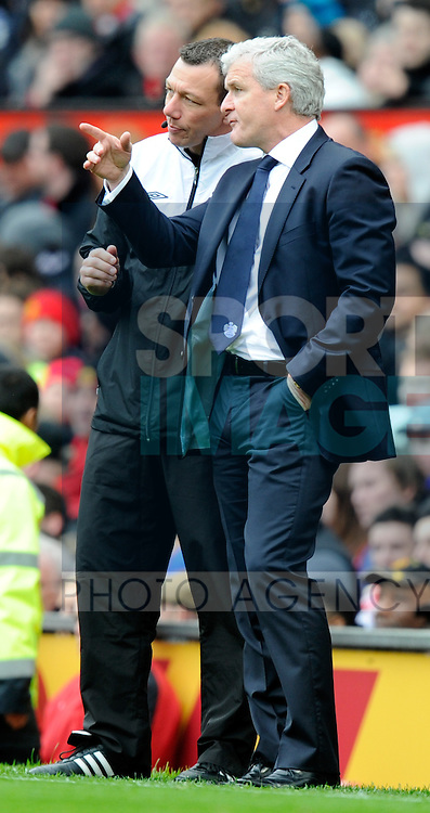 Mark Hughes manager of QPR complains to the fourth official following the sending off.Barclays Premier League match between Manchester Utd v QPR at Old Trafford Stadium, Manchester on the 8th April 2012..Sportimage +44 7980659747.picturedesk@sportimage.co.uk.http://www.sportimage.co.uk/.