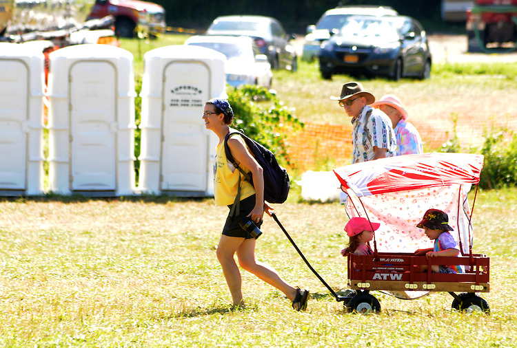 Woman pulling a wagon of children at the Falcon Ridge Folk Festival, held on Dodd's Farm in Hillsdale, NY on Sunday, August 2, 2015. Photo by Jim Peppler. Copyright Jim Peppler 2015.