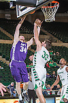 Stephen F. Austin Lumberjacks forward Jacob Parker (34) blocks North Texas Mean Green forward Colin Voss (33) during the game between the Stephen F. Austin Lumberjacks and the North Texas Mean Green at the Super Pit arena in Denton, Texas. SFA defeats UNT 87 to 53.